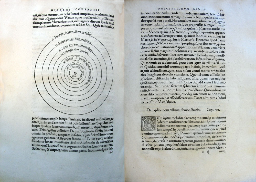 Copernicus's De Revolutionibus open at page 9 verso, with illustration showing the sun at the centre of the universe